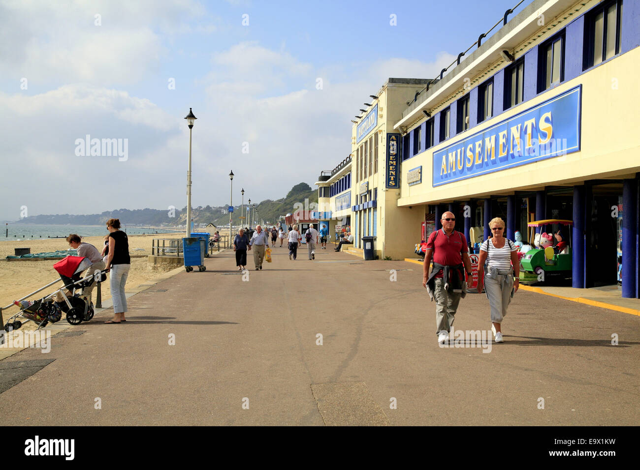 Tourists, holidaymakers and locals enjoy a walk on the promenade at Bournemouth, England, UK. - Stock Photo