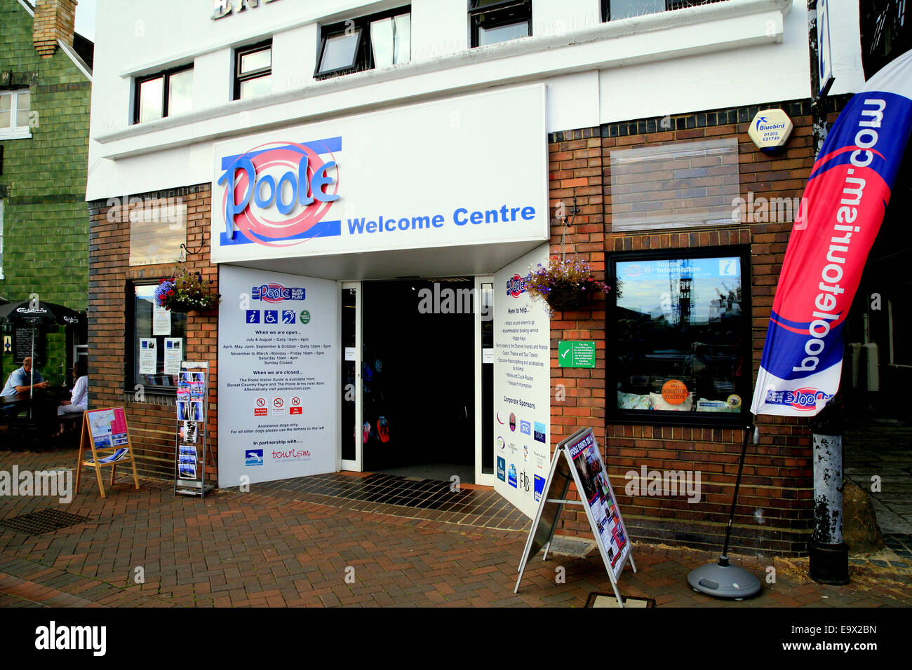 The Welcome Centre that provides tourism information on the quayside of Poole harbor, Dorset, England, UK. - Stock Image