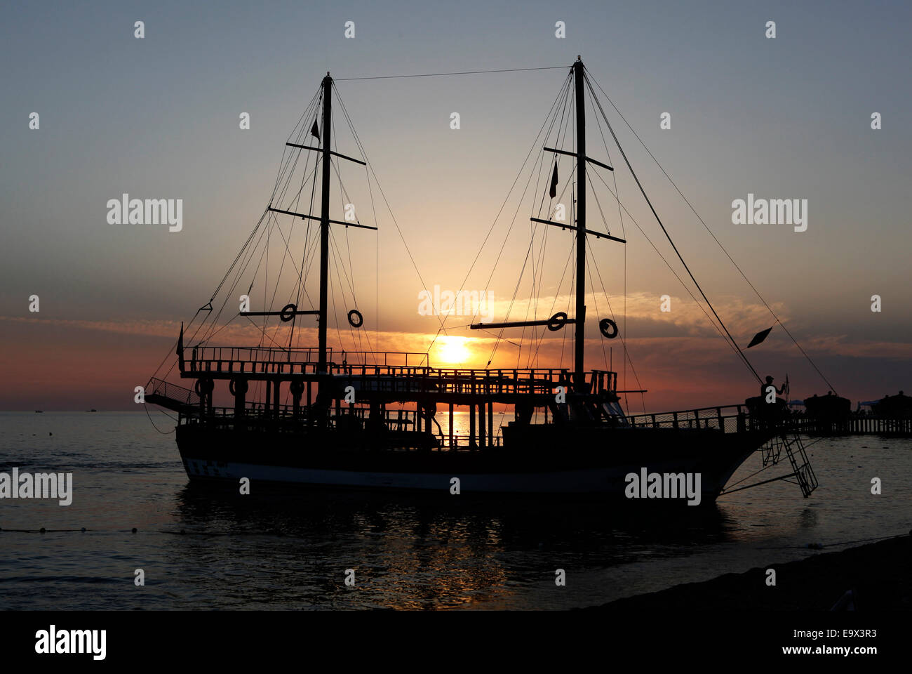 Excursion sailing boat anchored on the beach at sunset, Manavgat, Antalya, Turkey, Asia - Stock Image