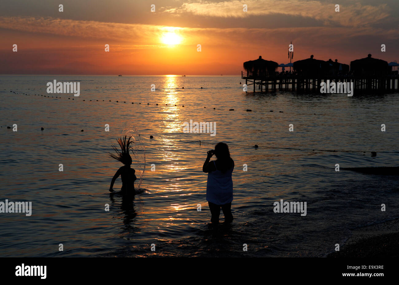 Two young women on the beach at sunset, Manavgat, Antalya, Turkey, Asia - Stock Image