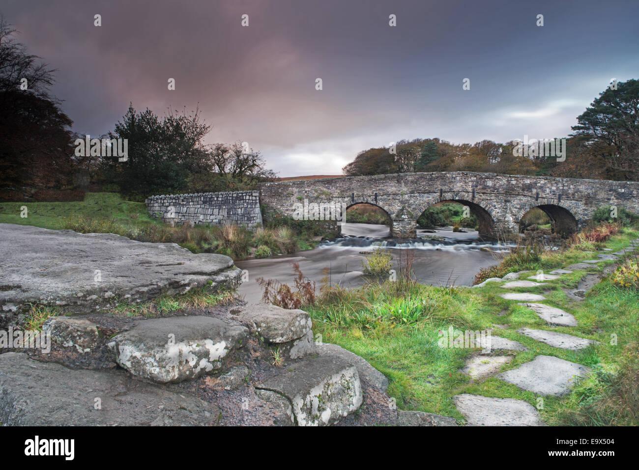 Clapper Bridge at Postbridge on the East Dart River. Dartmoor National Park,  Devon, England, Uk - Stock Image