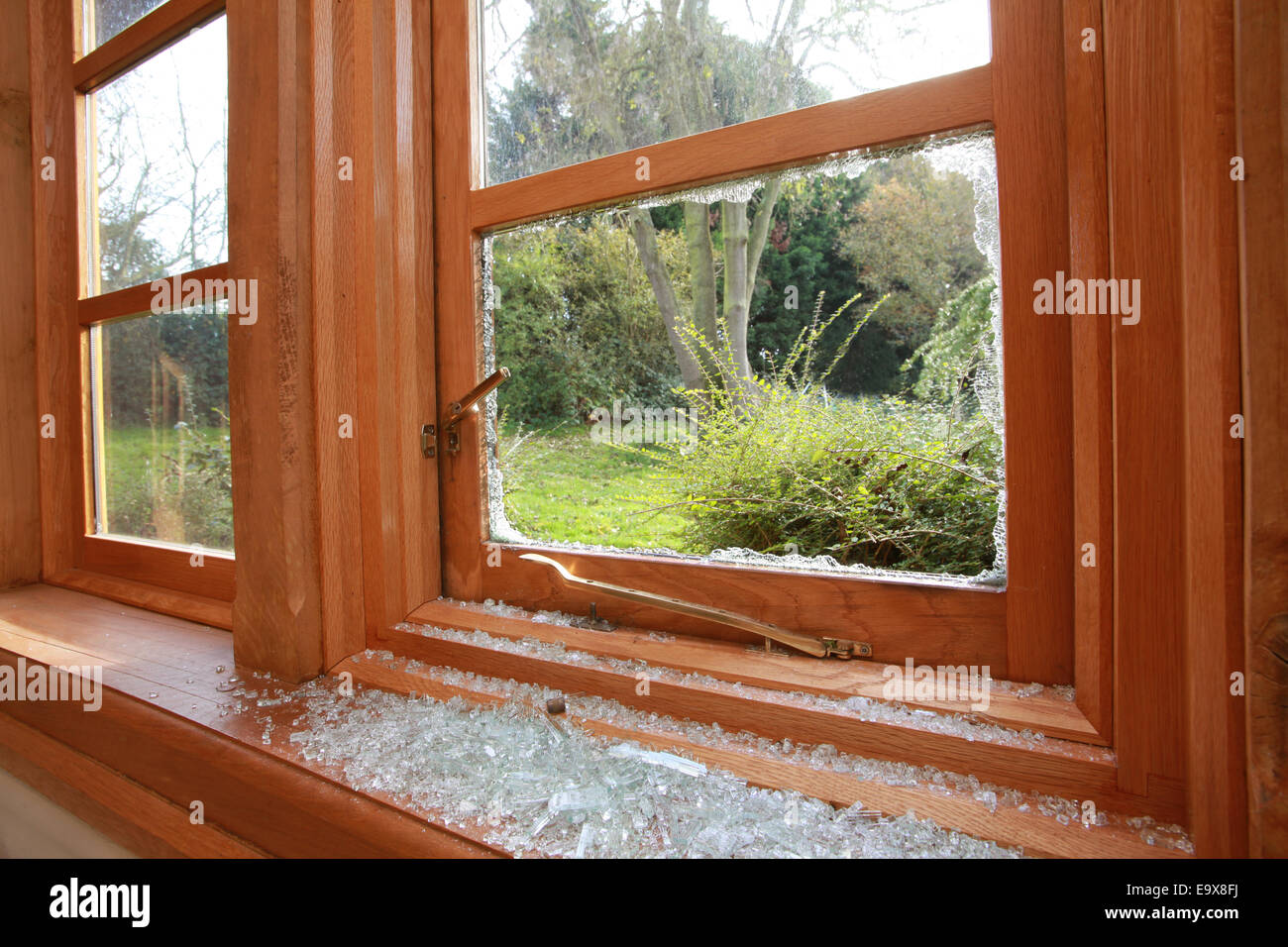 broken window after break in - Stock Image