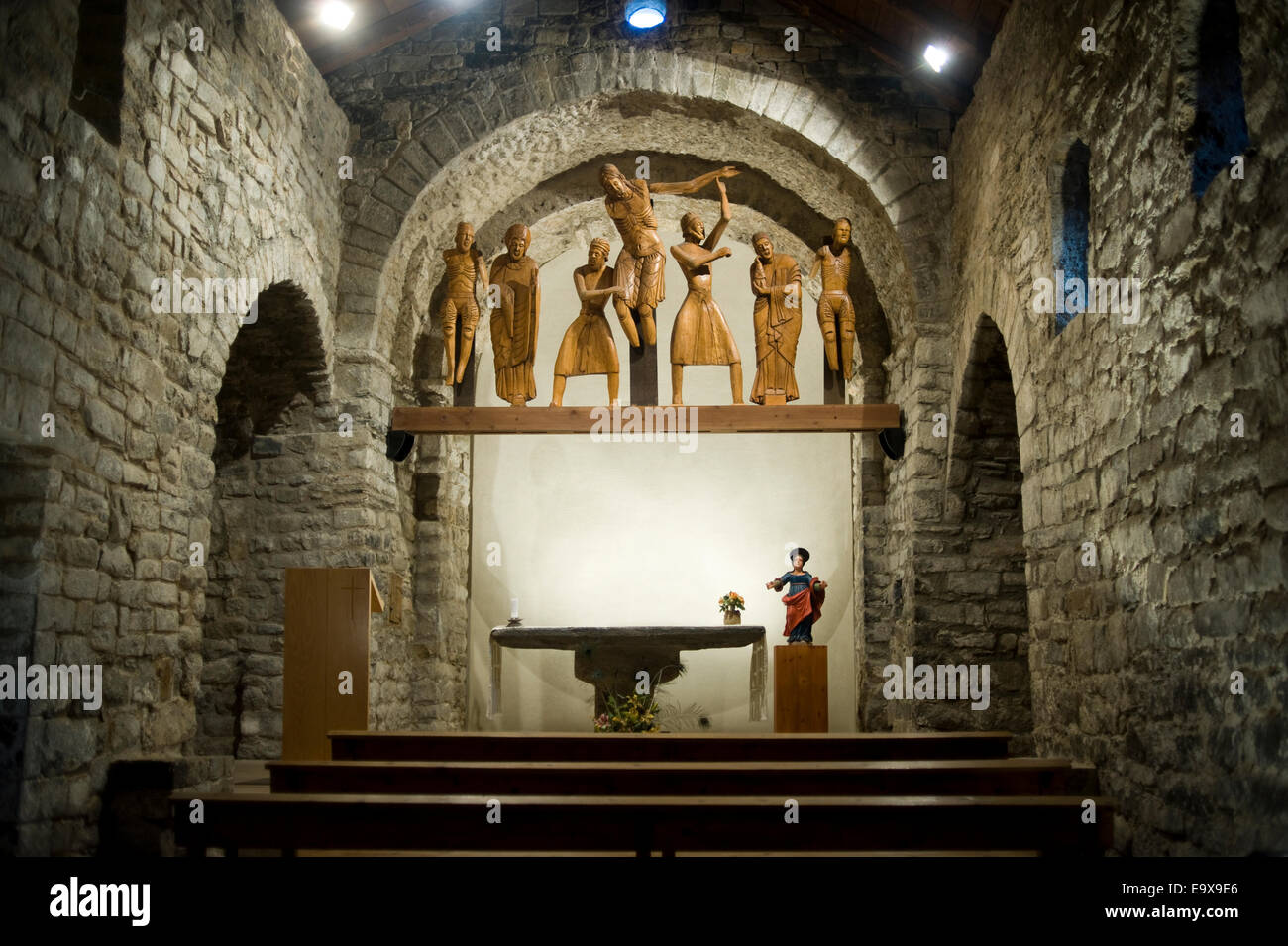 Santa Eulalia romanesque church in Erill la Vall. Vall de Boi, Lleida, Catalonia Spain. Descent from the Cross wooden - Stock Image