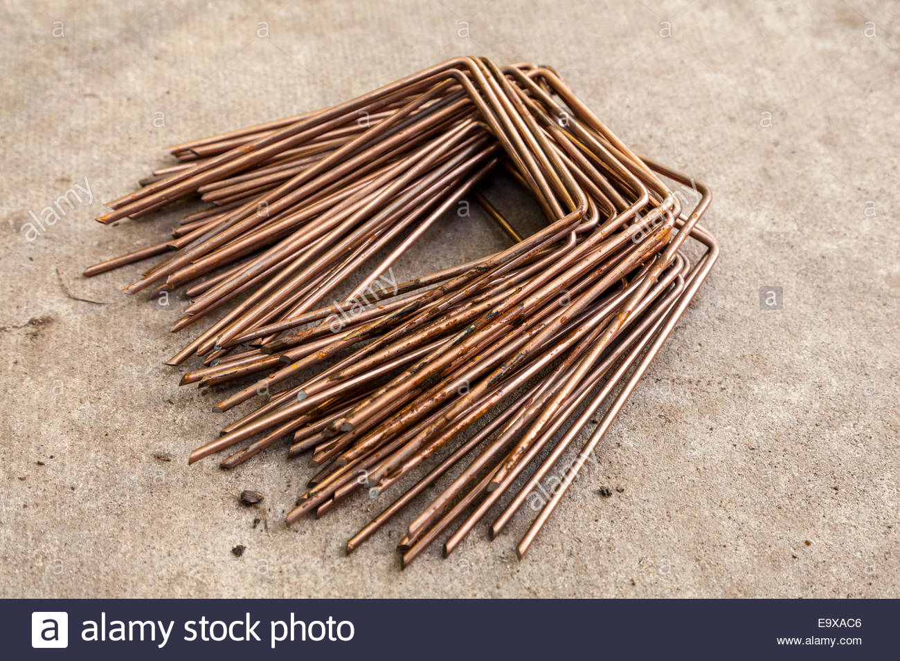 Securing pins or staples for ground fabric - Stock Image