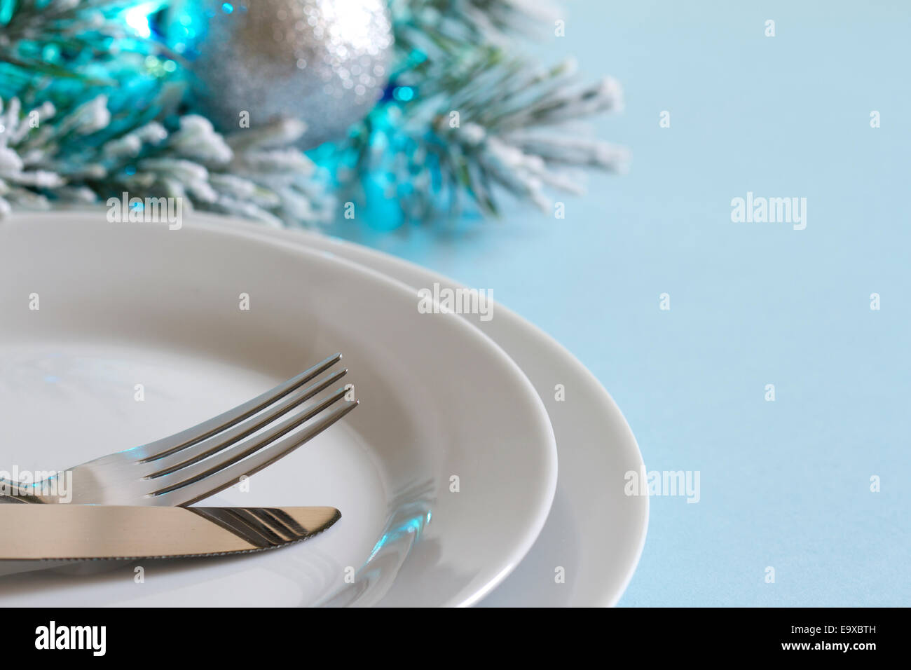 Christmas table with cutlery and tableware abstract background - Stock Image