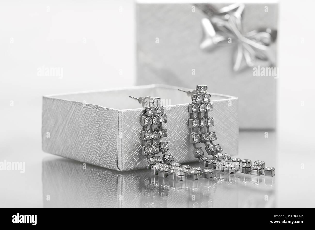 Earrings in a silver box. - Stock Image