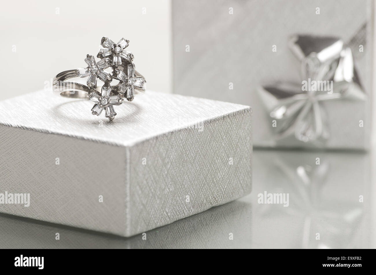 An engagement ring in a silver box. - Stock Image