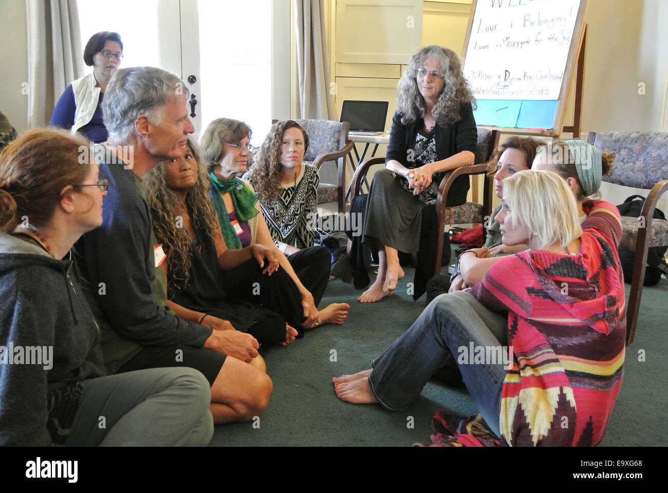 adult in group therapy constellation workshop interact with others at Esalen Institute in Big Sur California Stock Photo
