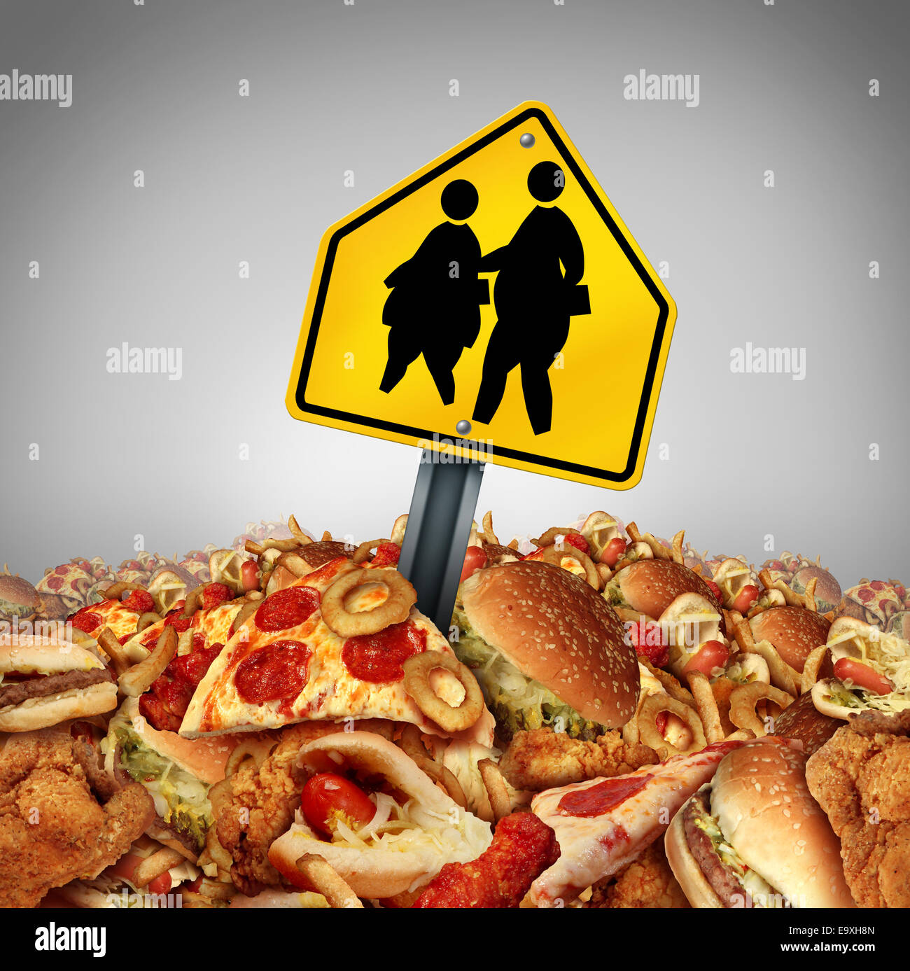 Children diet problems and obesity crisis in the school concept as a heap of unhealthy fast food with two overweight - Stock Image