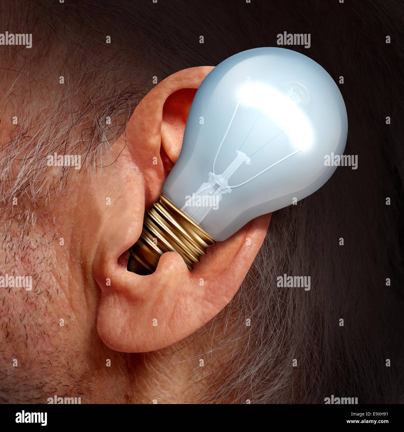 Listen to ideas concept as a lightbulb inside a human ear as a symbol of listening and tuning in to creative thoughts - Stock Image