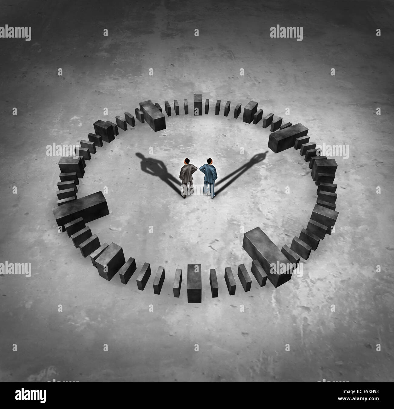 Business time concept as two businessman standing in the middle of a sundail clock with their cast shadows as hour - Stock Image