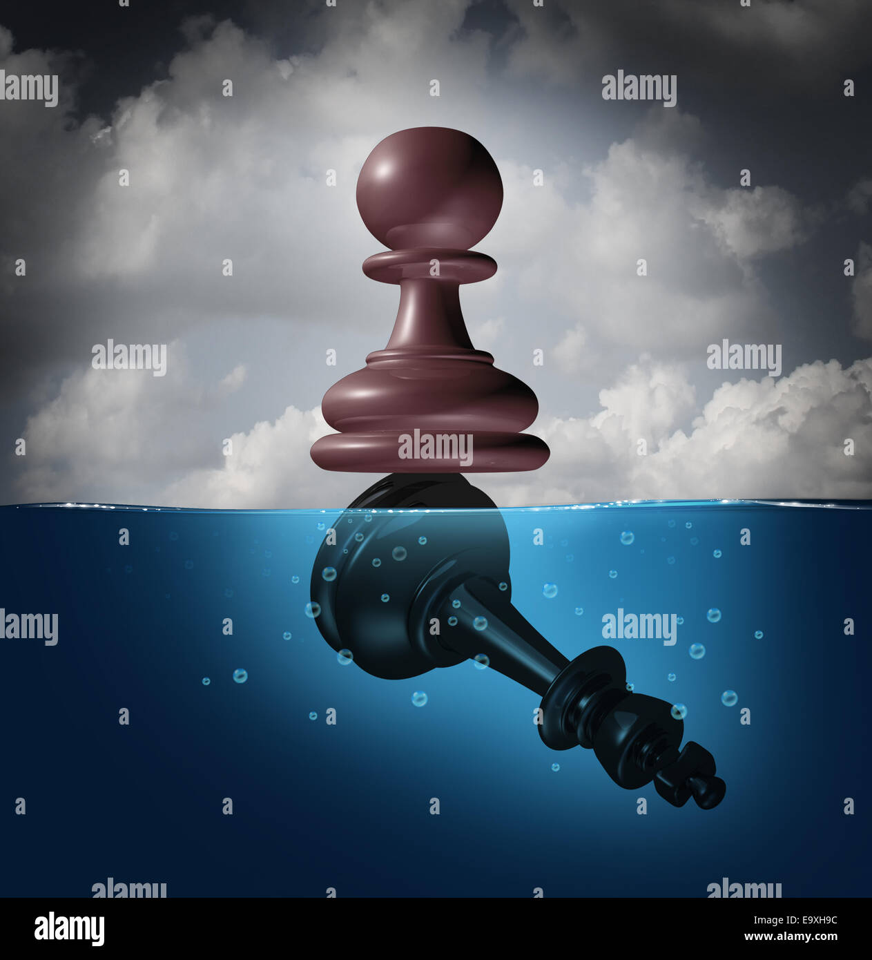 Winner and champion success concept as a chess pawn piece standing on top of a drowning king as a business metaphor - Stock Image