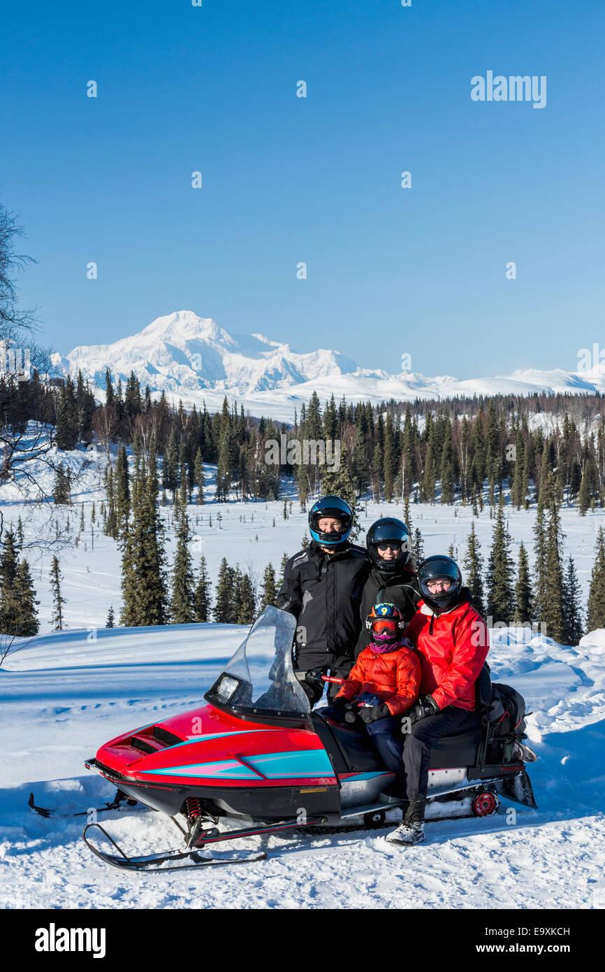 Snowmobile,Alaska,Mount Mckinley,Snow,Family - Stock Image
