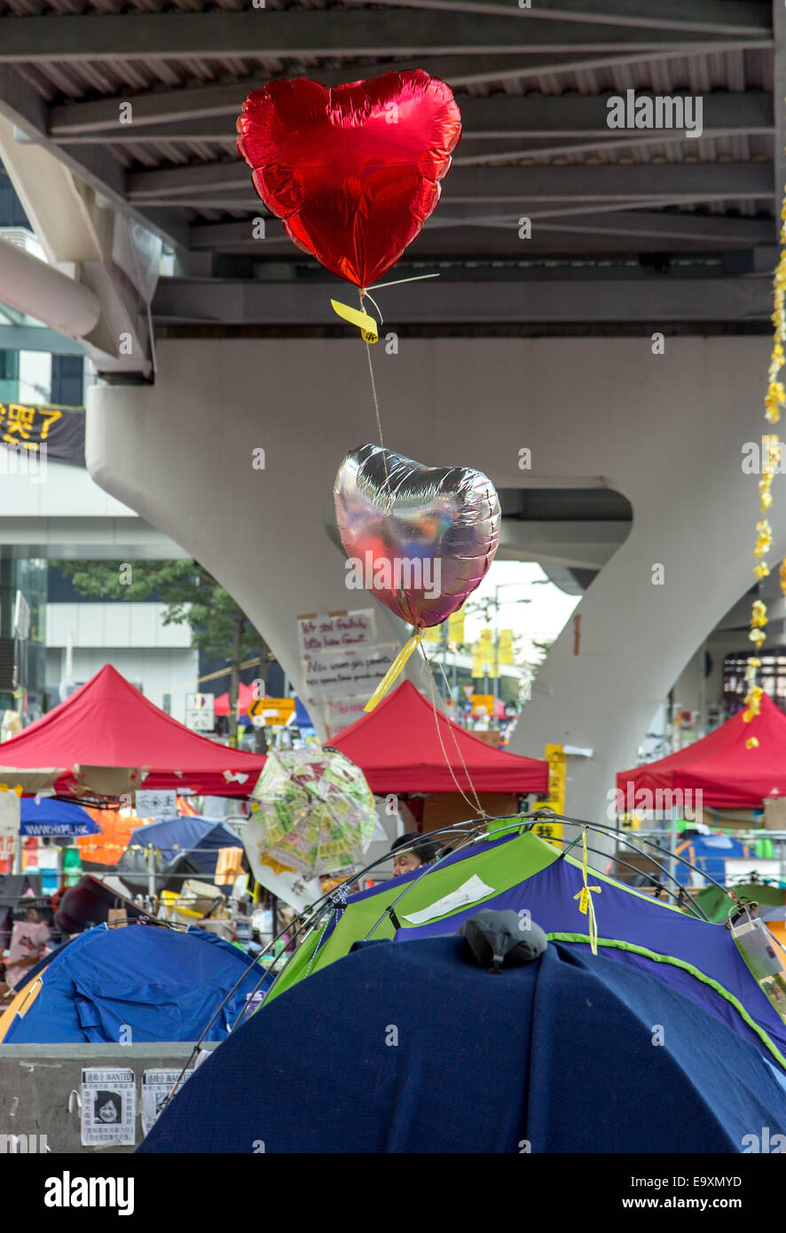 heart flutters above the tents of protesters in Hong Kong - Stock Image