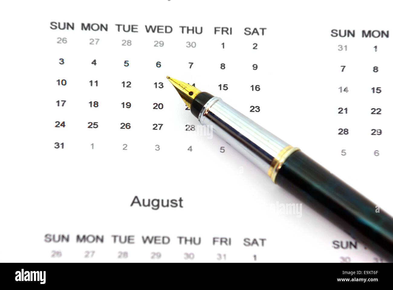 Close up image of a pen on a calendar. - Stock Image