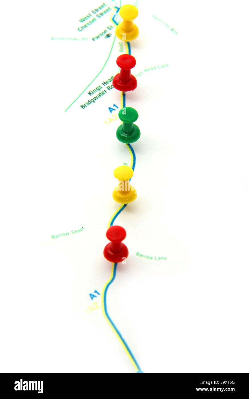 Route planning on map with pushpins. - Stock Image