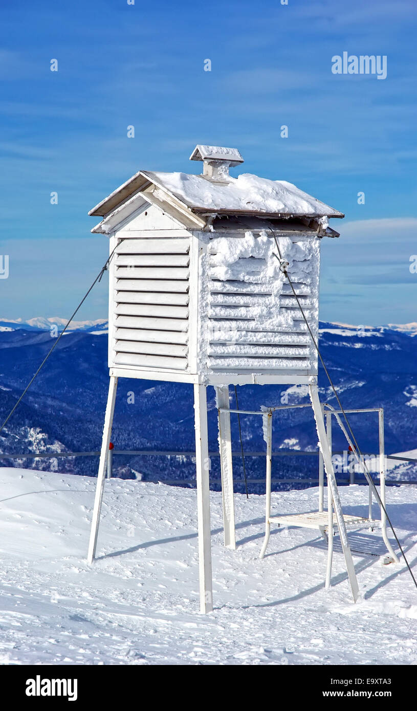 Meteorological station, frozen thermometer in winter. - Stock Image