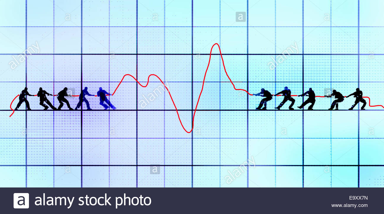 Men in tug-of-war teams pulling line graph in opposite directions - Stock Image