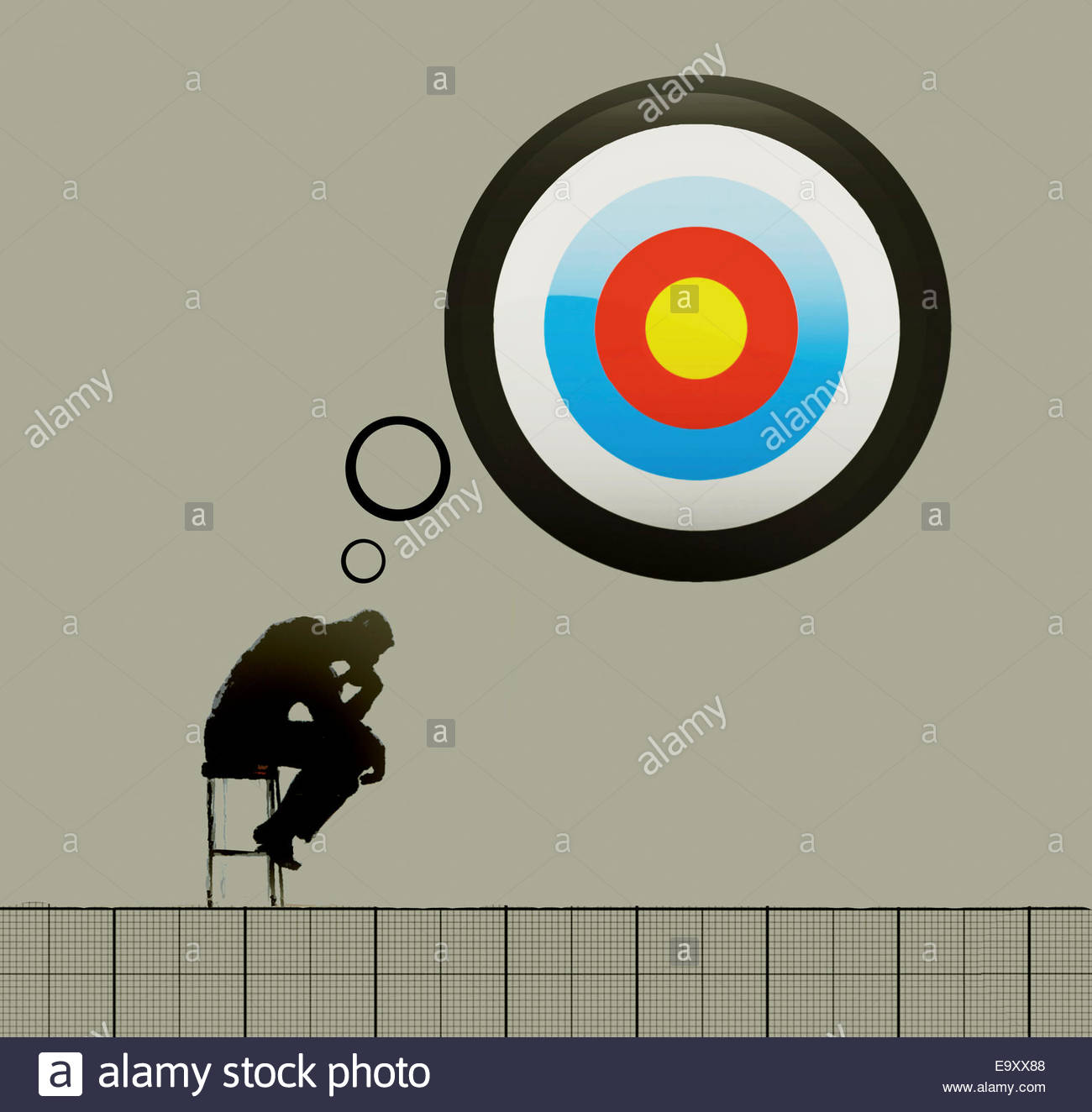 The Thinker with target thought bubble - Stock Image