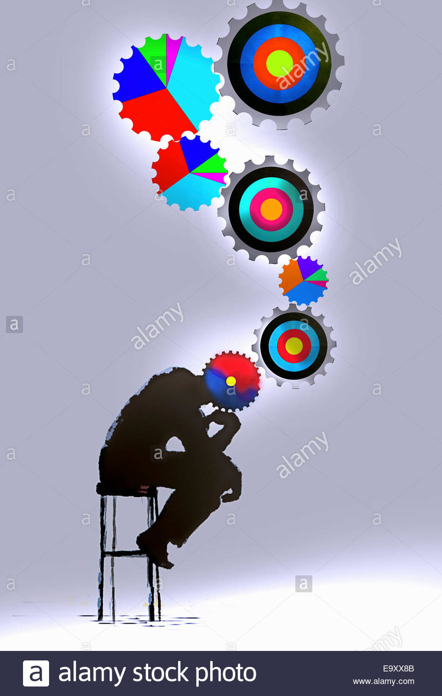 The Thinker with connected multicolored target and pie chart cogs - Stock Image