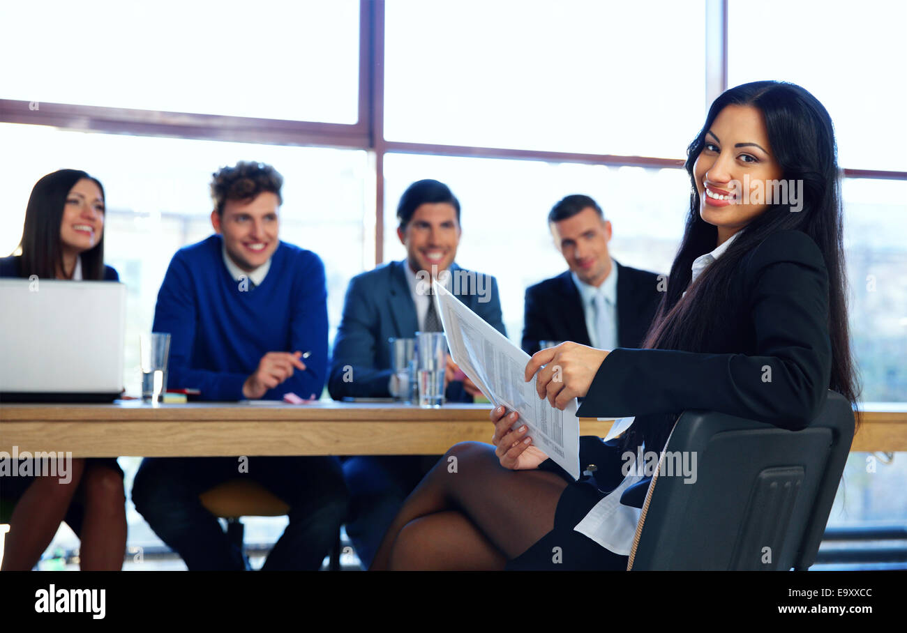 Business woman sitting at interview in office - Stock Image