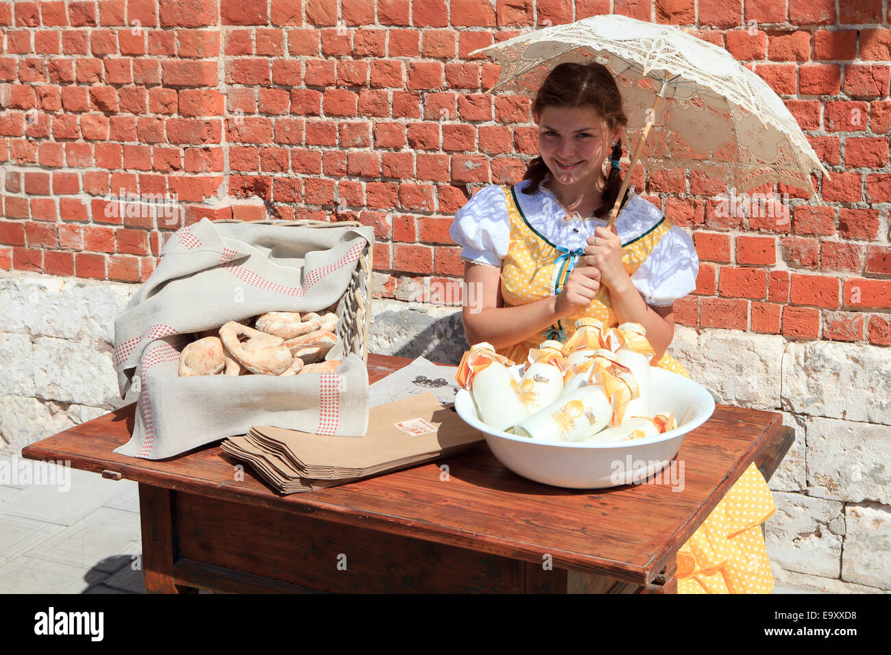 Girl in traditional dress outside the Pastry Museum in Kolomna, Russia Stock Photo