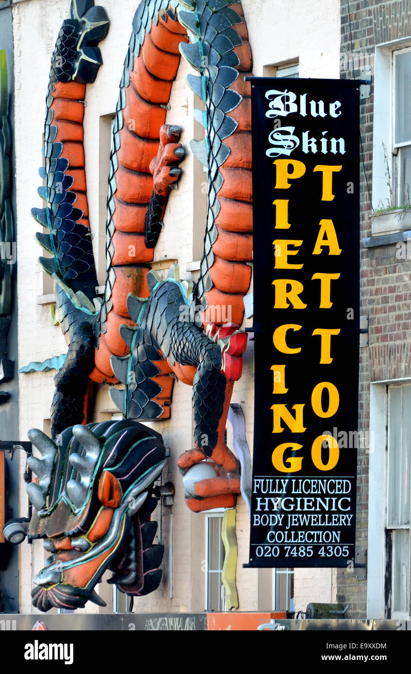 London, England, UK. Blue Skin Tattoo and Piercing in Camden High Street - Stock Image