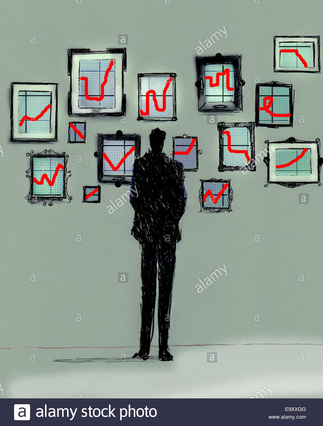 Businessman looking at gallery of different line graph charts on wall - Stock Image