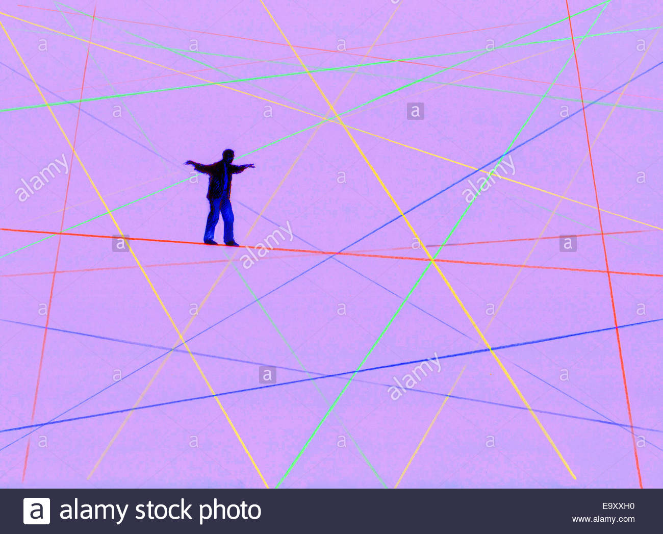 Man balancing walking on complex crisscross tightrope pattern - Stock Image