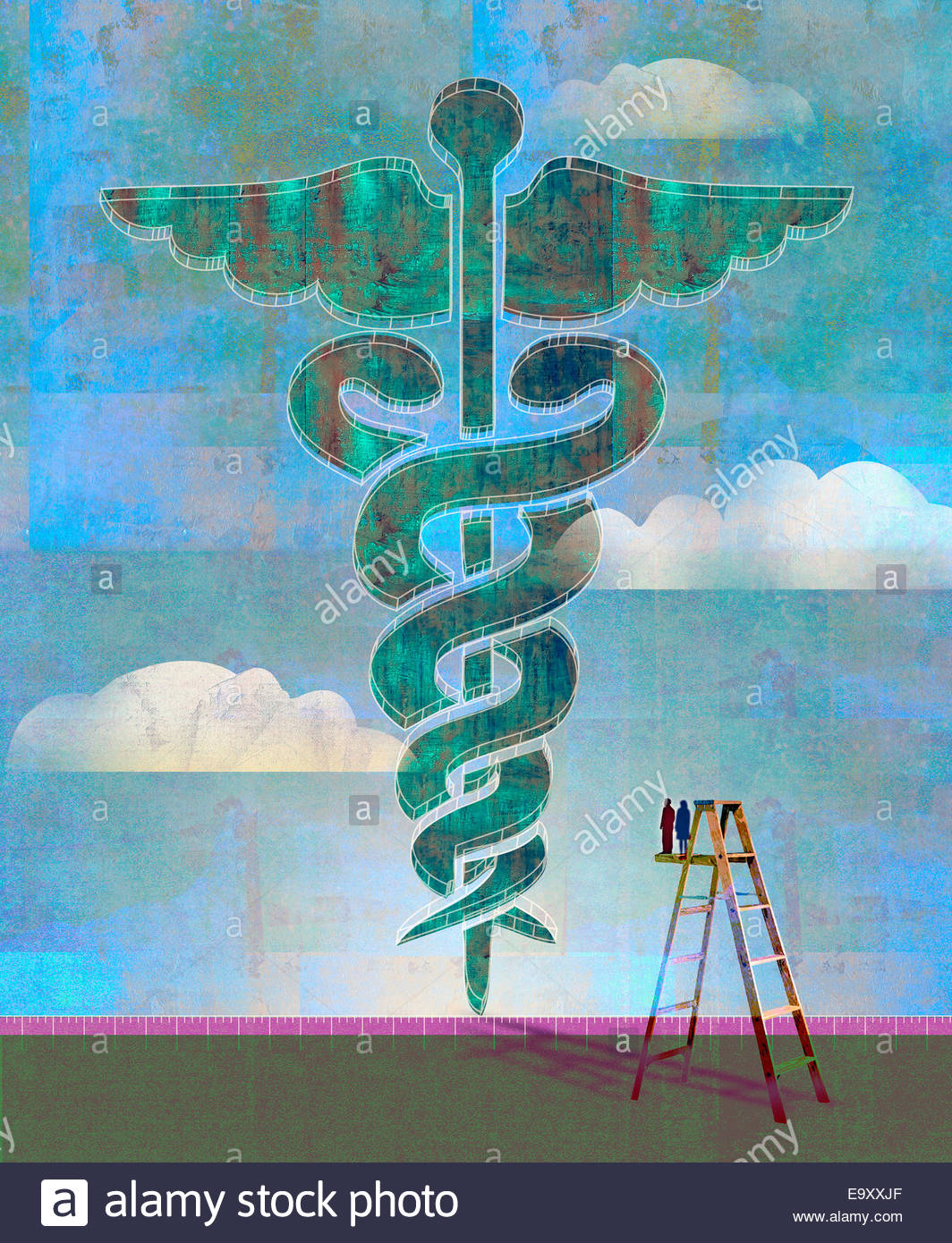Couple on ladder looking at enormous caduceus - Stock Image
