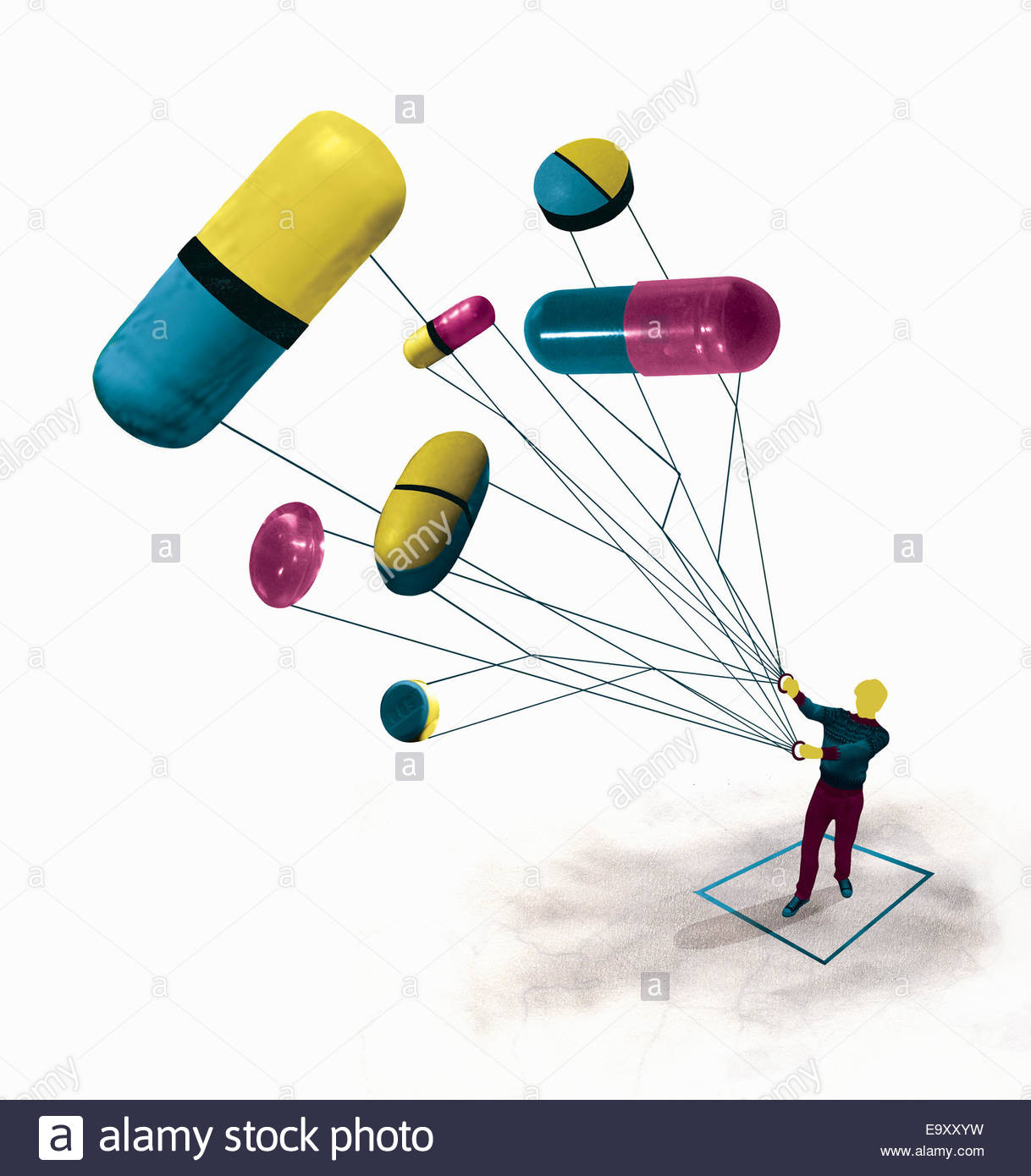 Man flying pills and medicine capsules as kite - Stock Image