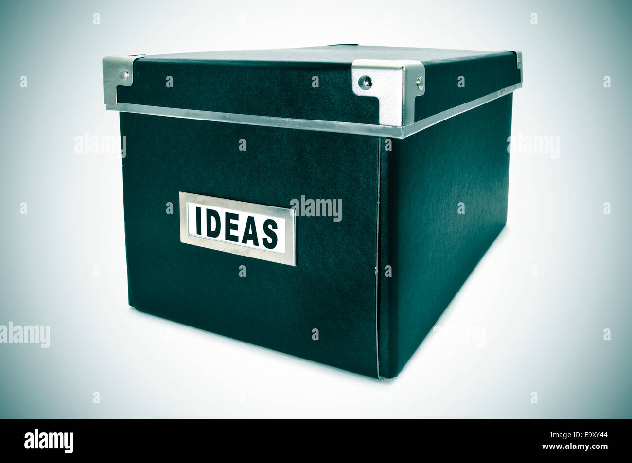 a black cardboard storage box with the word ideas written in the index card - Stock Image