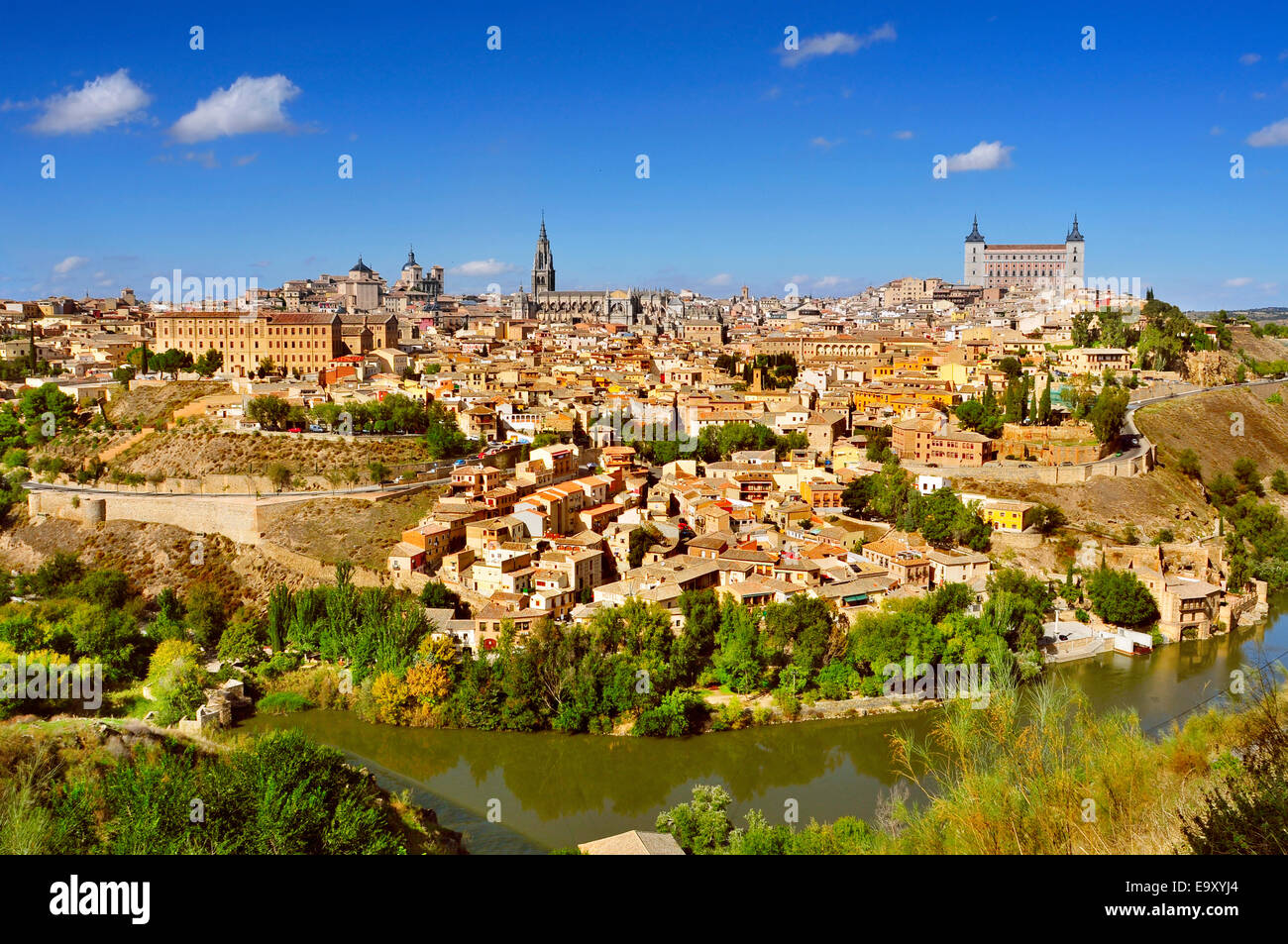a panoramic view of Toledo, Spain, with the Tagus river in the foreground and the imposing Alcazar in the background Stock Photo