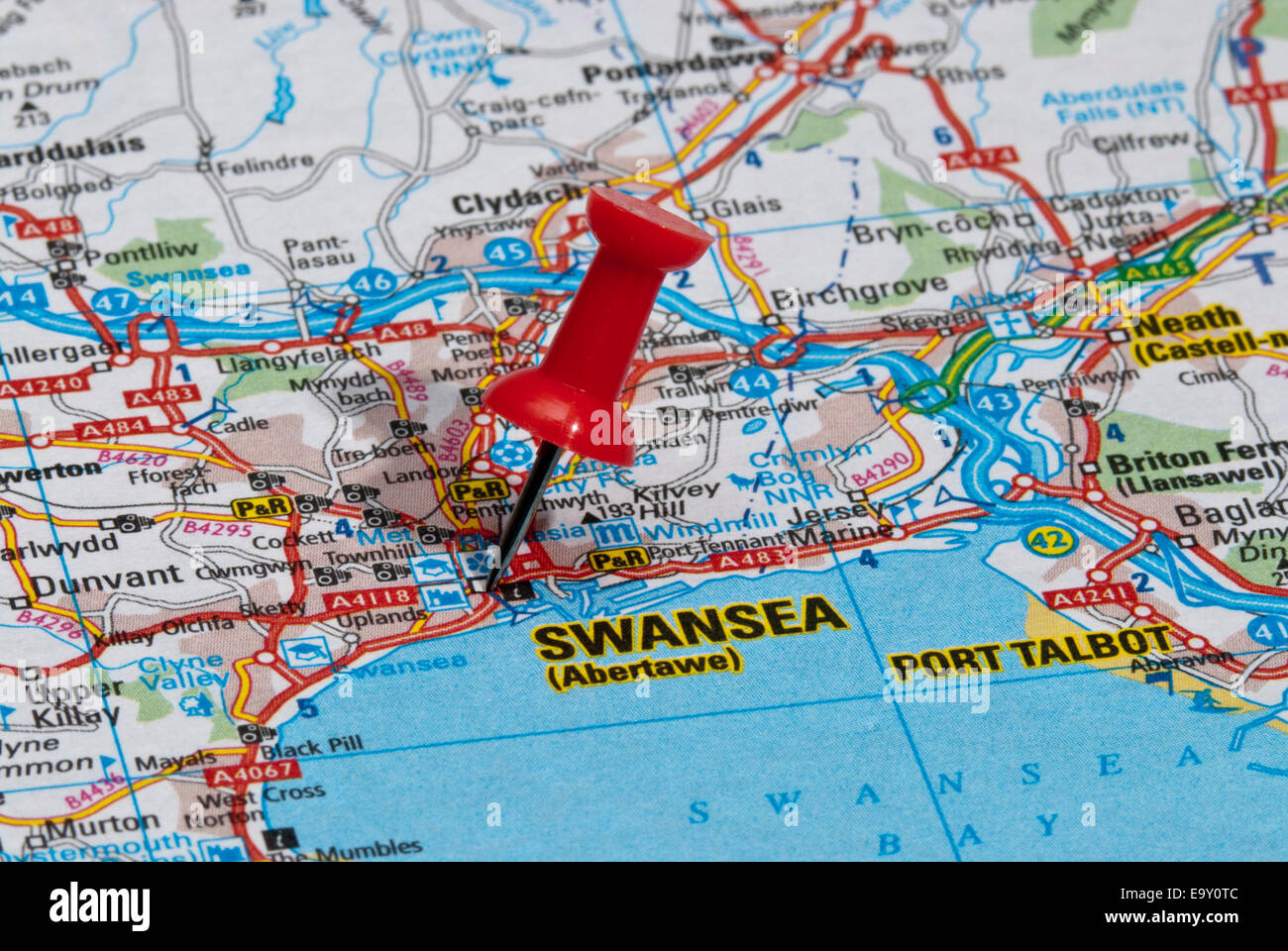 red map pin in road map pointing to city of Swansea Stock Photo
