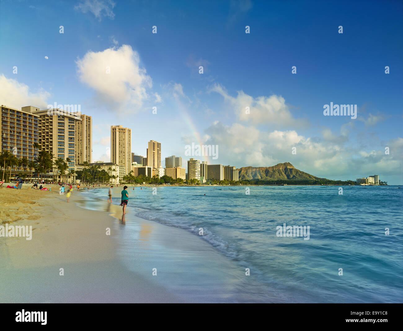 Rainbow over Waikiki Beach, Honolulu, Oahu, Hawaii, United States - Stock Image
