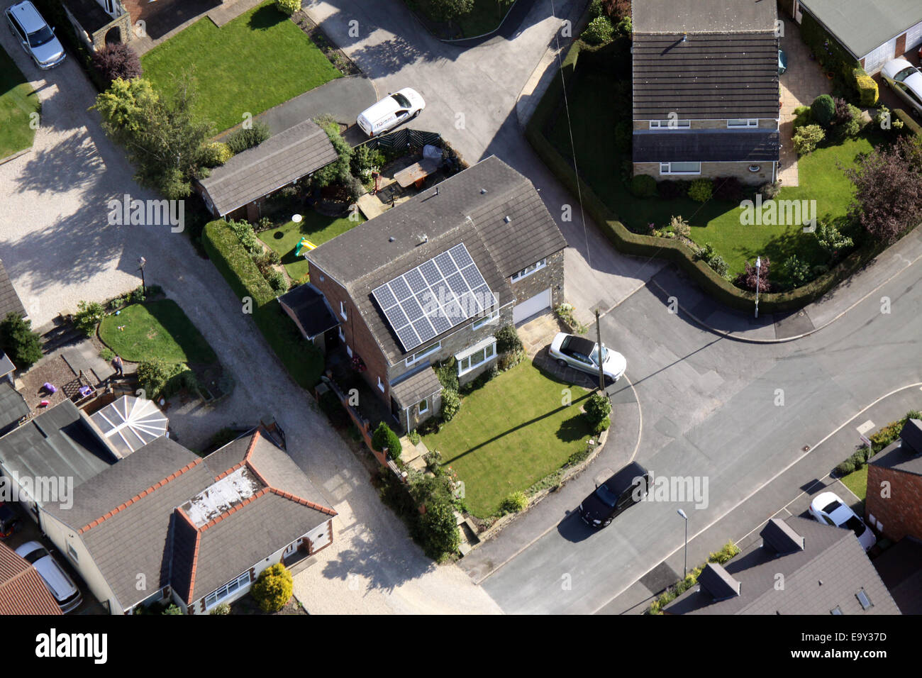 aerial view of a domestic house with solar panels on the roof, UK - Stock Image
