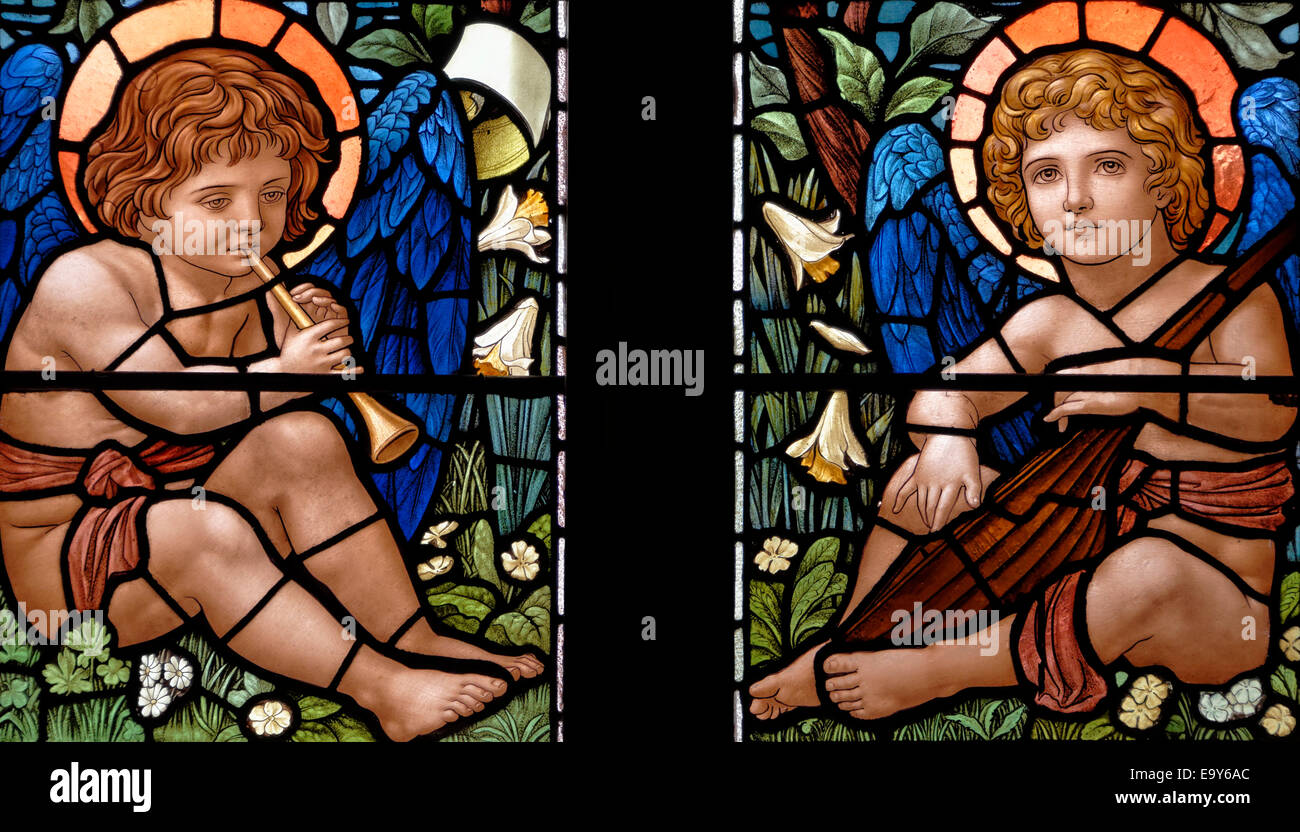 Two winged cherubs in the commemorative window to the step-daughters of Dora Wordsworth, Rydal Church, Lake District, - Stock Image