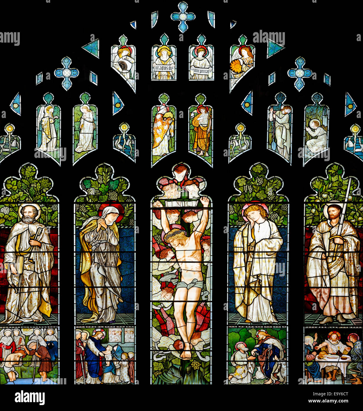 The Pre-Raphaelite East window of Jesus Church, Troutbeck, Lake District, Cumbria, England - Stock Image