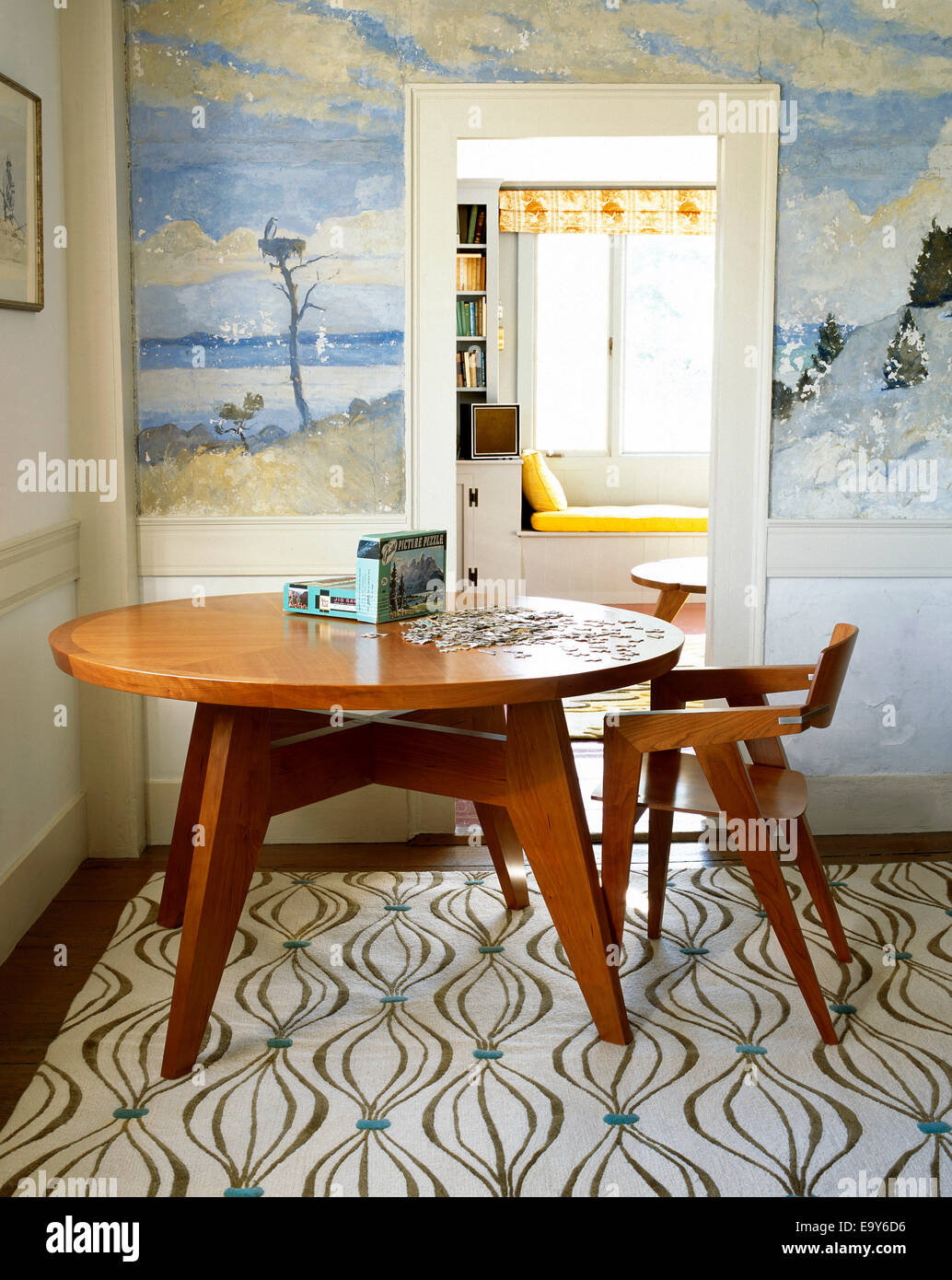 dining room table with picture puzzle - Stock Image