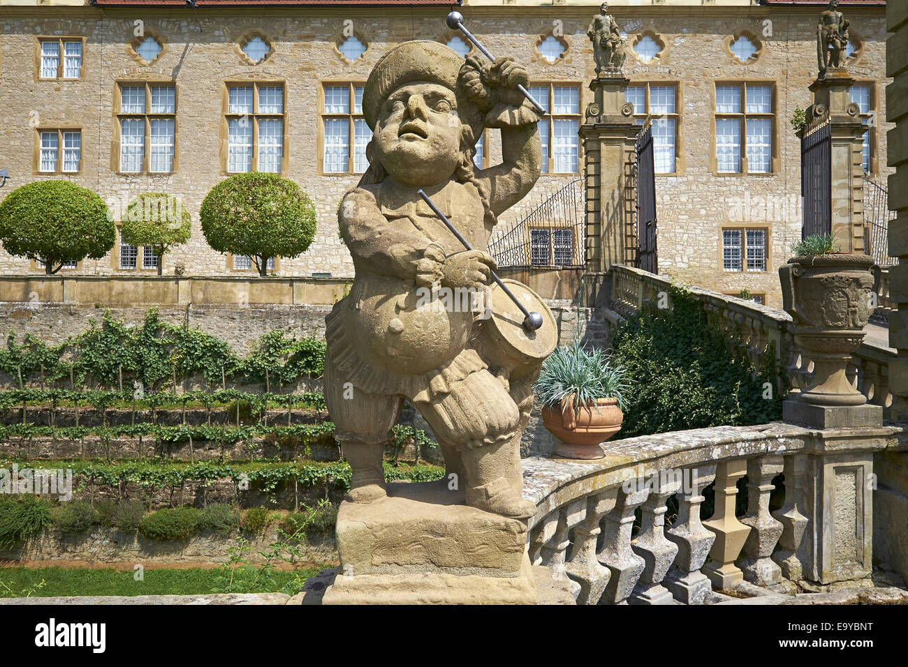 Sandstone figure of the drummer on Weikersheim Castle, Baden-Wuerttemberg, Germany - Stock Image