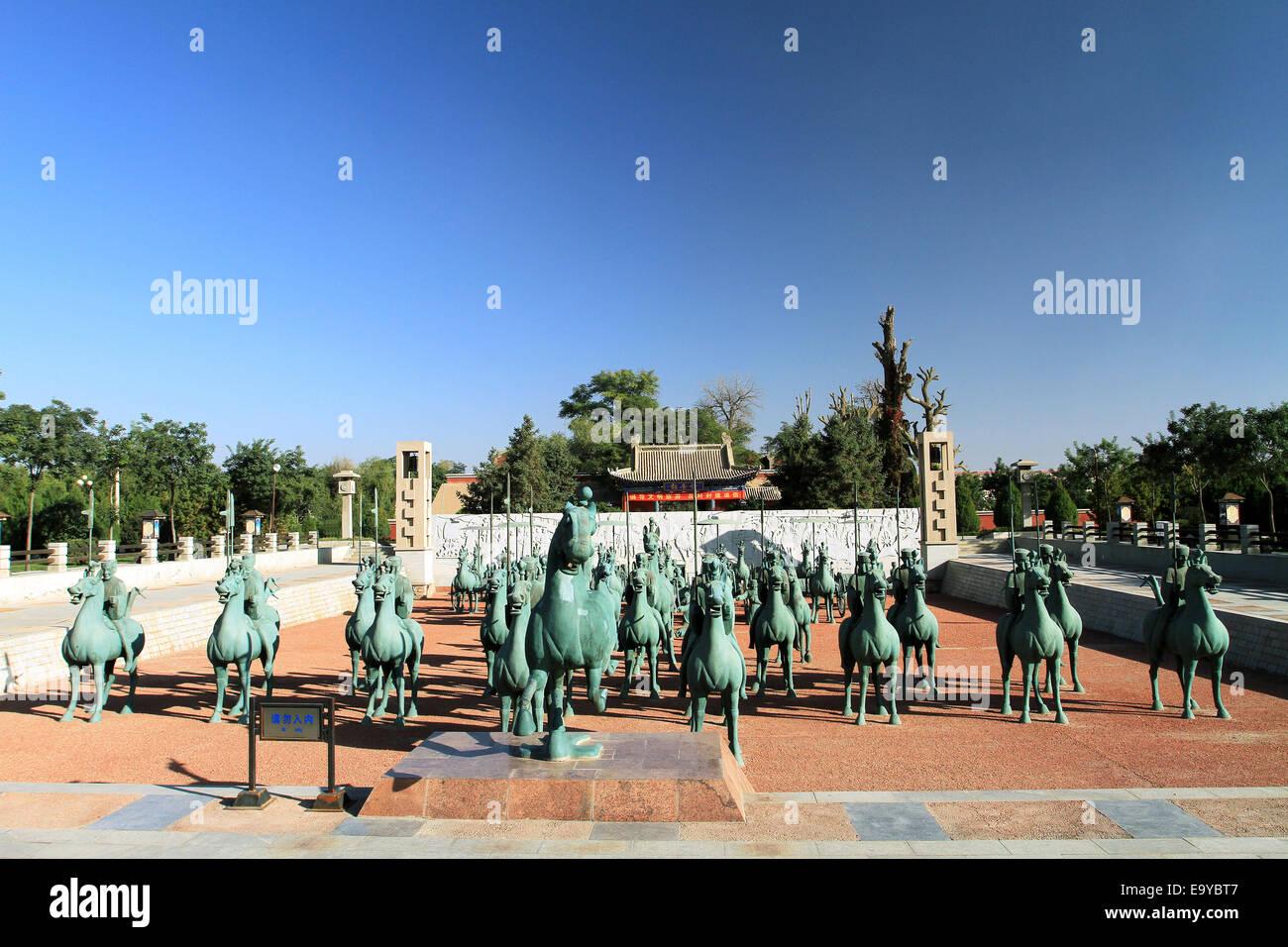 Wuwei City , Gansu Tong Juma team sculpture - Stock Image