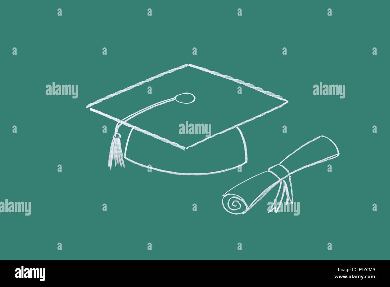 Diploma and graduation cap drawn on blackboard - Stock Image