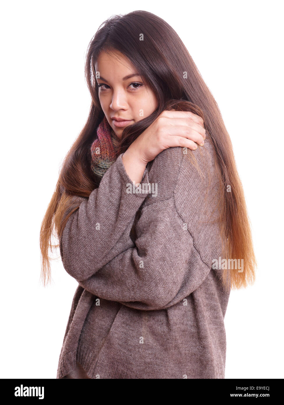 young asian woman is freezing - Stock Image