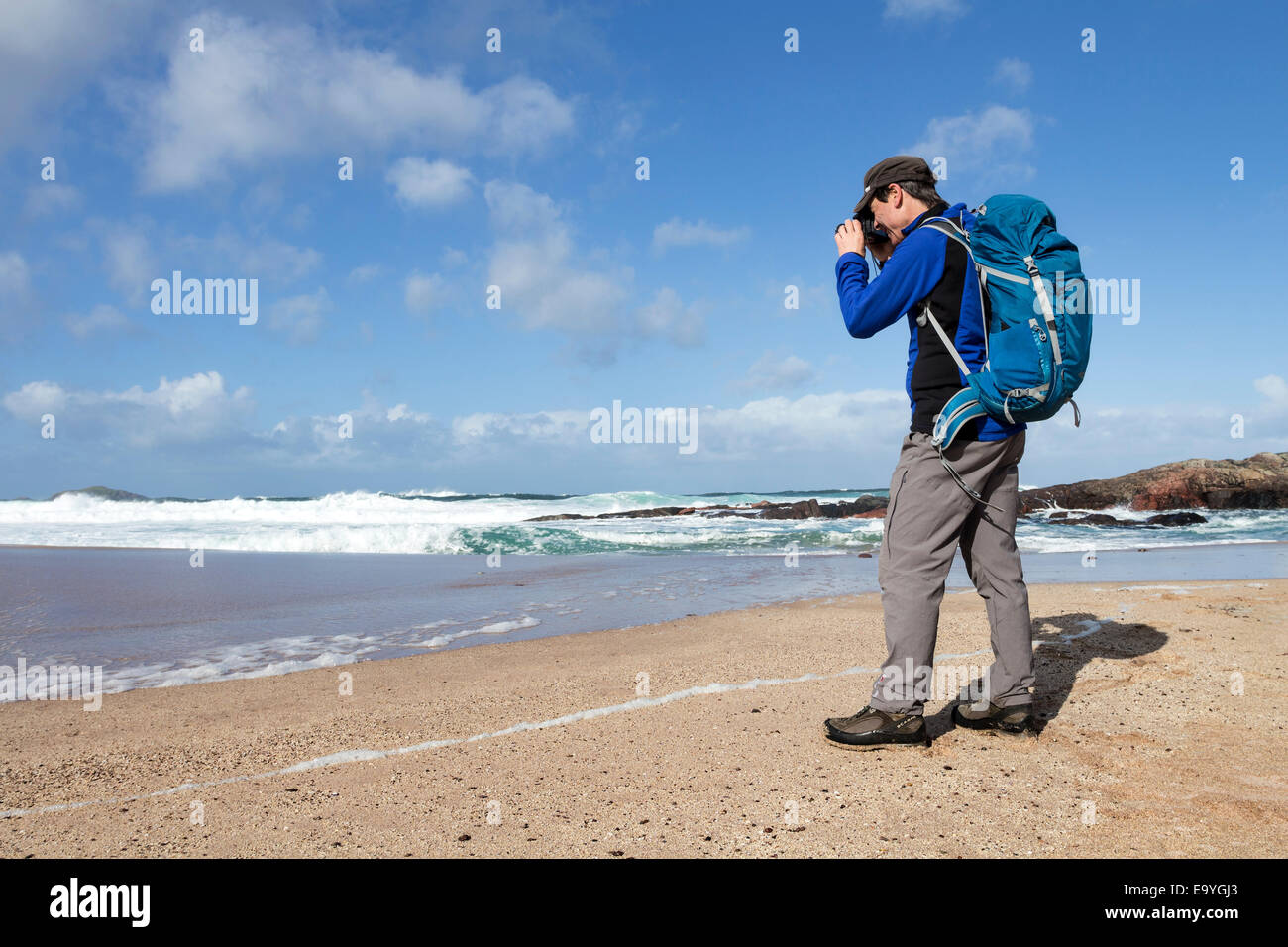 Walker Photographing the Sea at Sandwood Bay Sutherland Scotland UK - Stock Image