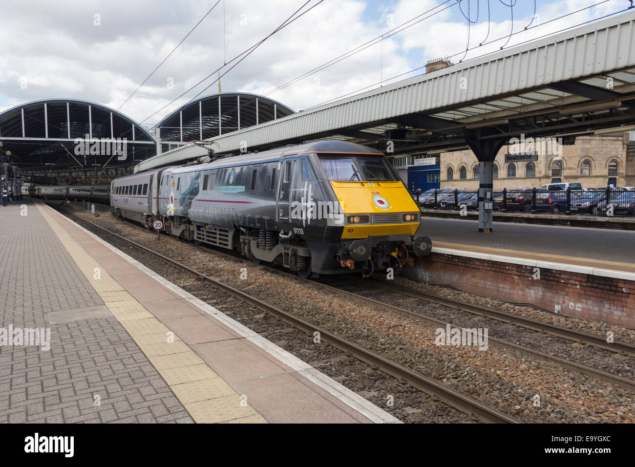 East Coast Class 91  locomotive 91110 'Battle of Britain Memorial Flight' at Newcastle station on a northbound - Stock Image