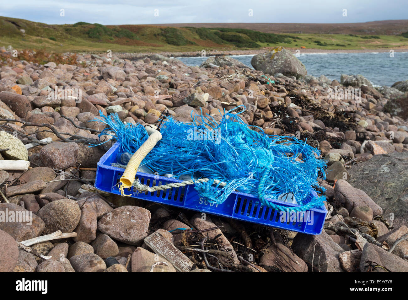 Plastic Rubbish Washed up on the Shore Which has Been Collected Together for Removal from the Beach at  Red Point - Stock Image