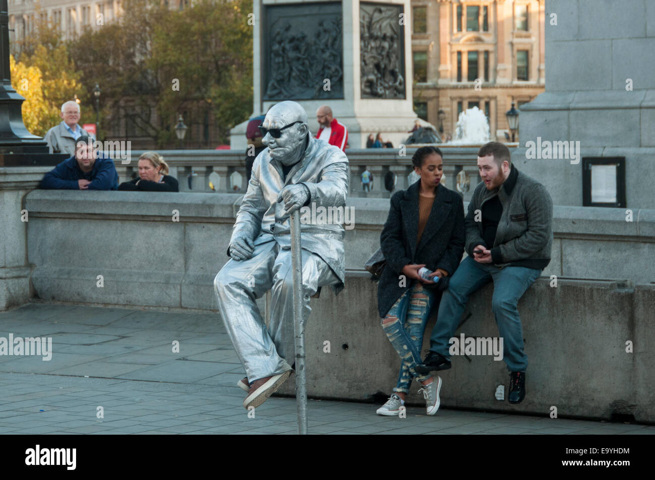 living statue street artist in Trafalgar Square London England - Stock Image
