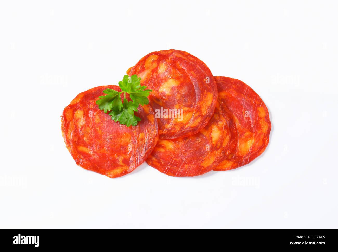 Spanish sausage seasoned with smoked pimenton - thin slices - Stock Image