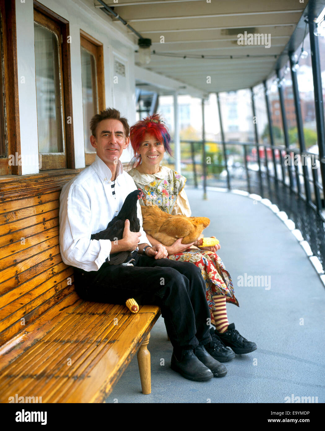 couple on house boat  with chickens - Stock Image