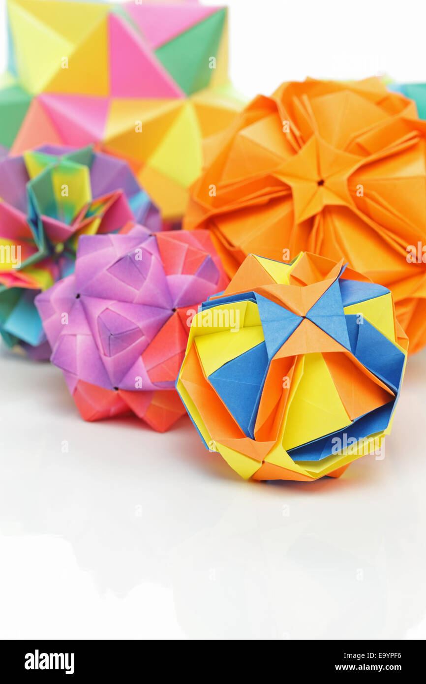 Group of colourful origami geometric polyhedron balls - Stock Image